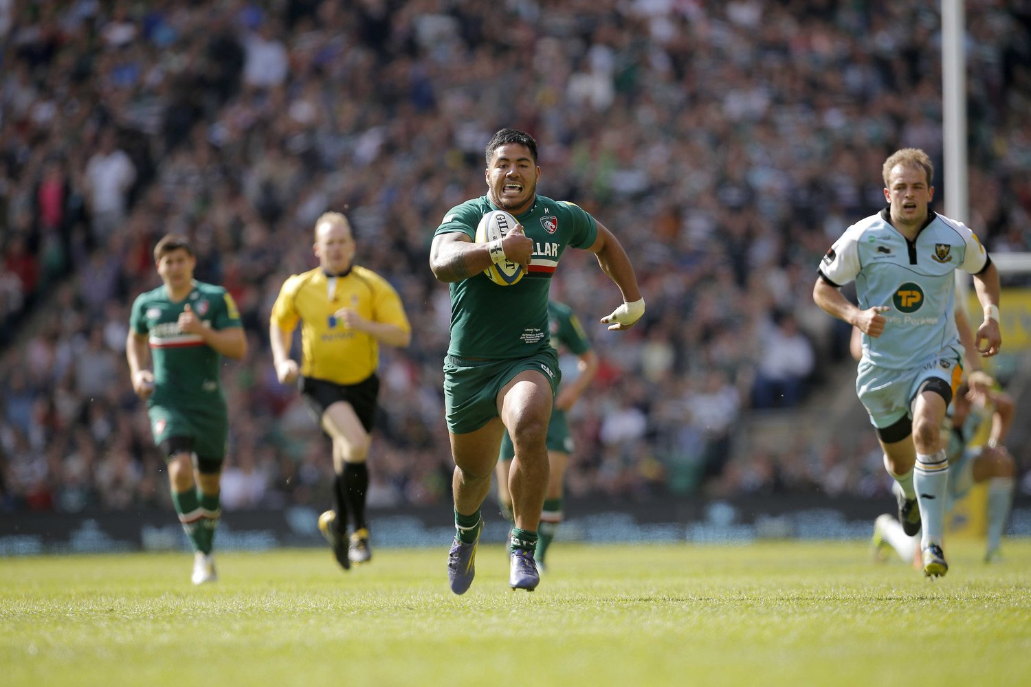 Manu Tuilagi runs in at Twickenham against the local rivals as Tigers are crowned champions