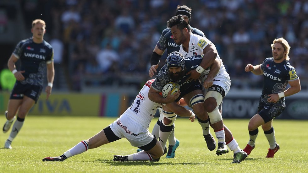 Tigers close in to make a tackle on Josh Strauss in the win over Sale Sharks on Saturday