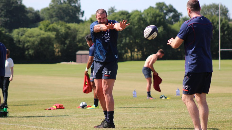 Will Spencer works on his passing technique with Tigers skills coach Geordan Murphy during pre-season 2018/19.