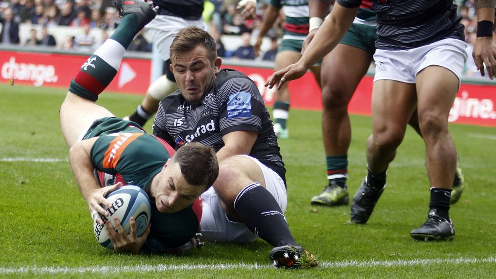 George Ford reaches out to score despite the efforts of former Tigers hooker George McGuigan
