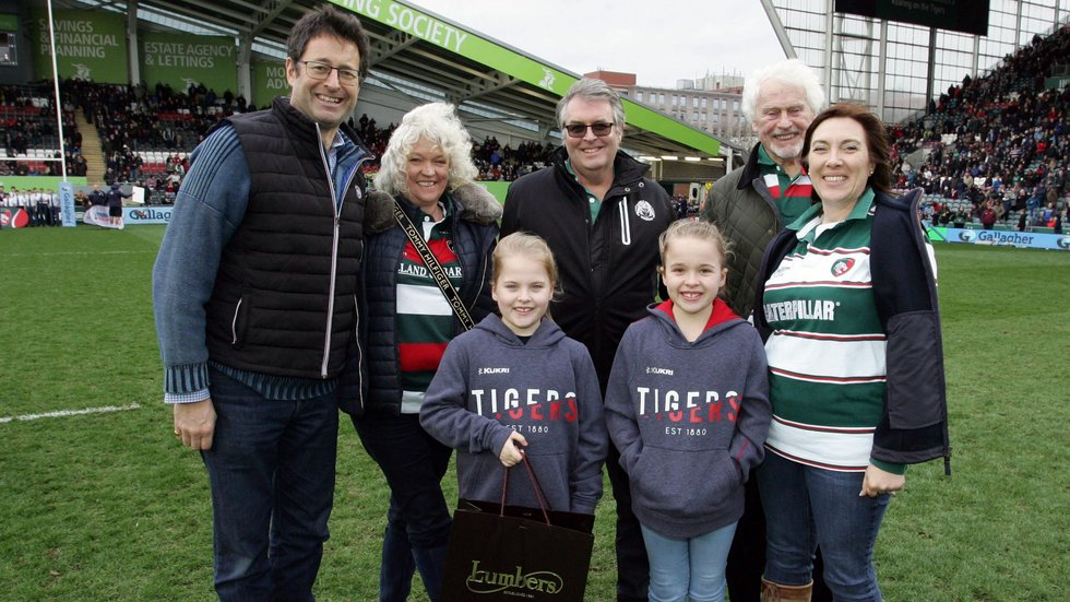 Lumbers managing director Dominic Gomersall (left) was joined on the Welford Road pitch by guests of Lumbers as Harry Wells was named as the latest Player of the Month.