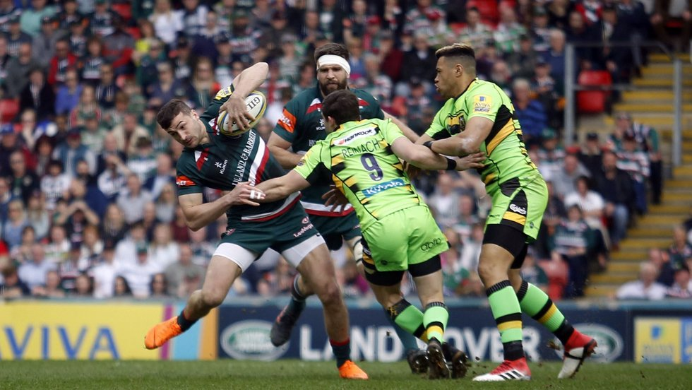 Jonny May squirms away from the Saints defence in last season's derby meeting at Welford Road