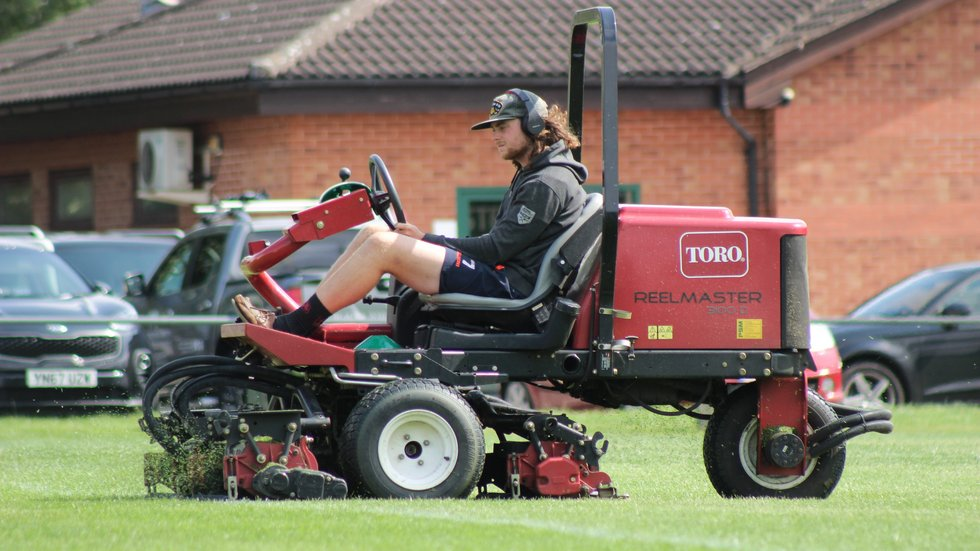 Tigers Groundsman, James Keywood working on the Training Ground pitches at Oval Park