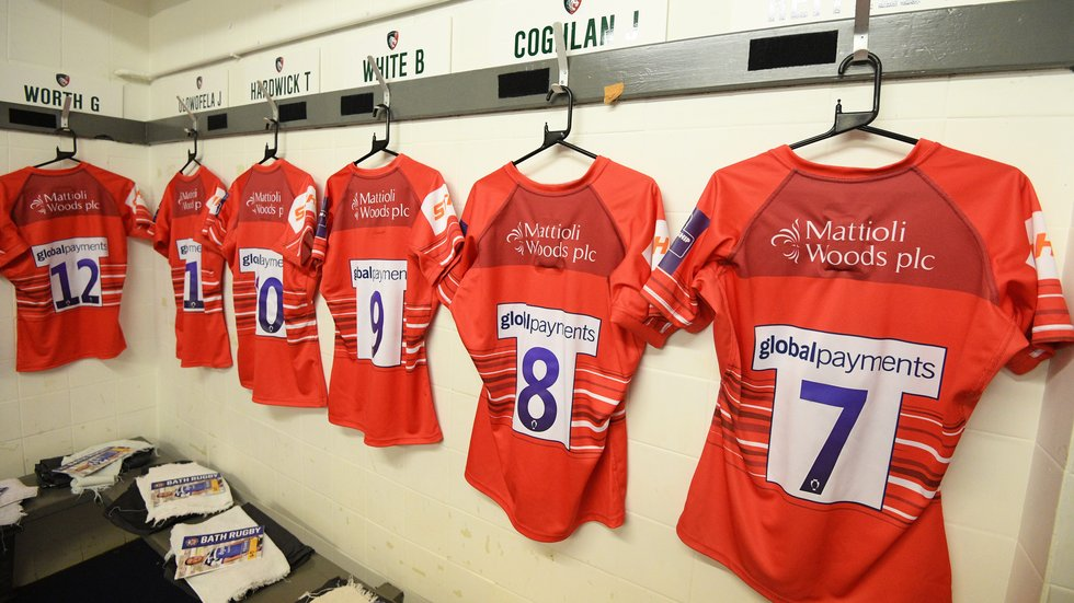 The Tigers fluoro-red alternate kit in the away changing room in Bath.