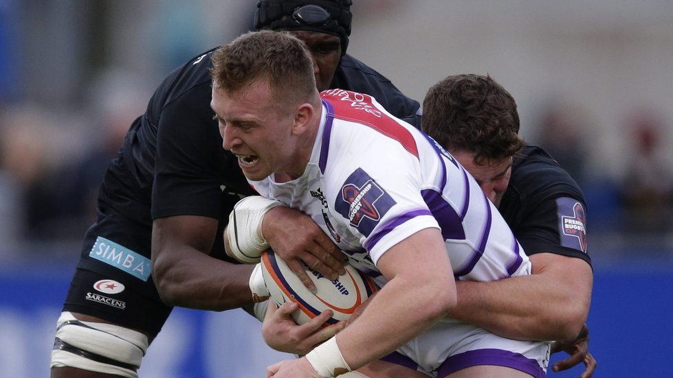 Tigers flanker Tommy Reffell tries to break through the Saracens defence at Allianz Park