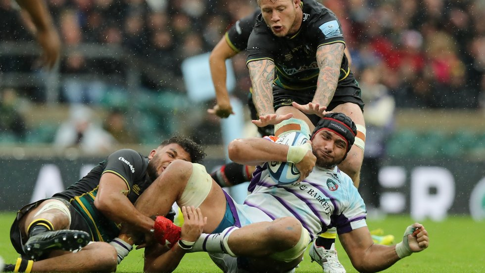 Sione Kalamafoni is brought to earth by the Saints defence at Twickenham