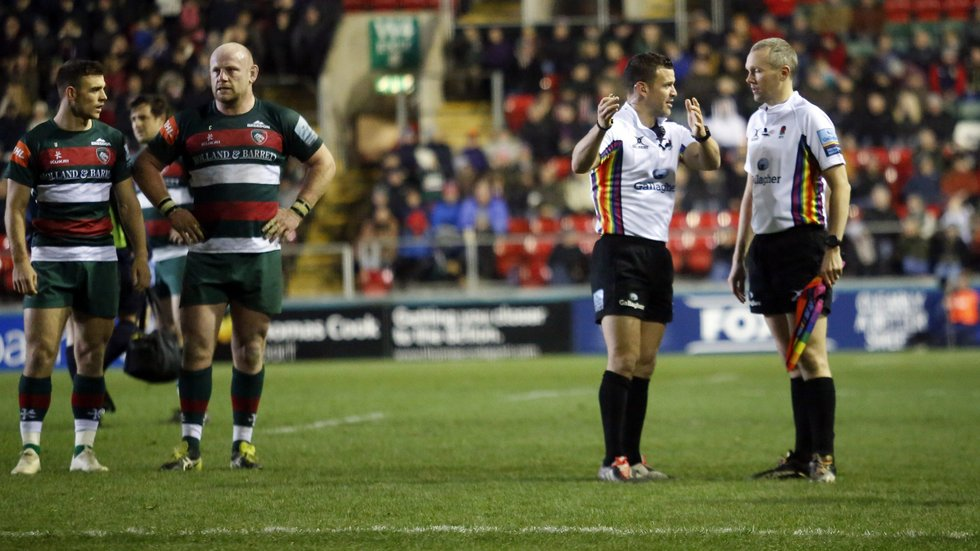 Referee Karl Dickson and his assistant discuss a key moment in the home game against Saracens