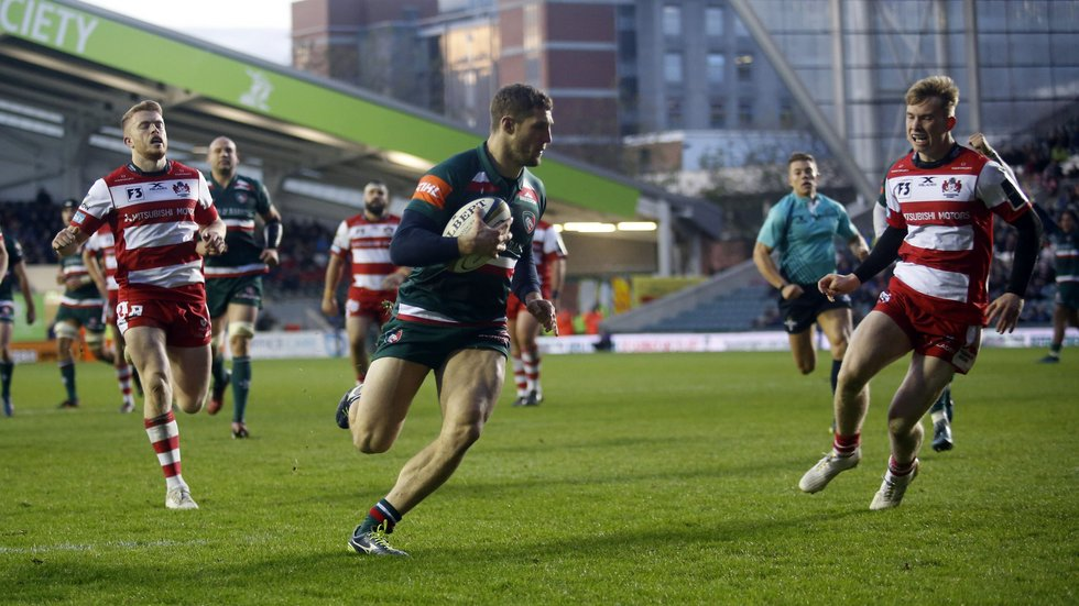 Jonah Holmes runs in to score a first try in his Tigers career