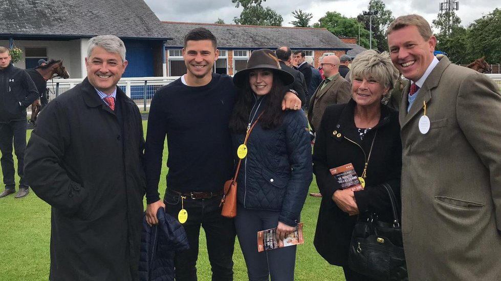Flo Jones (centre) also won a Tigers Racing Syndicate share worth £600 for her suggestion of 'Leg It Lenny'.