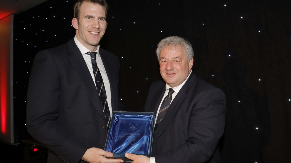Simon Cohen hands the Outstanding Service Award to Tom Croft