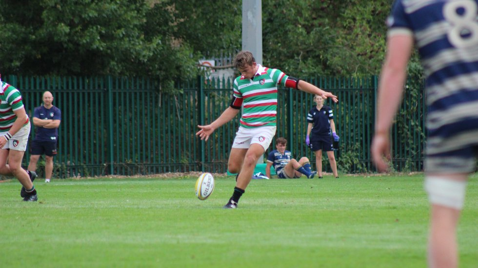 Tigers fly-half Harry Glynn gets the game under with a kick-off at Oval Park