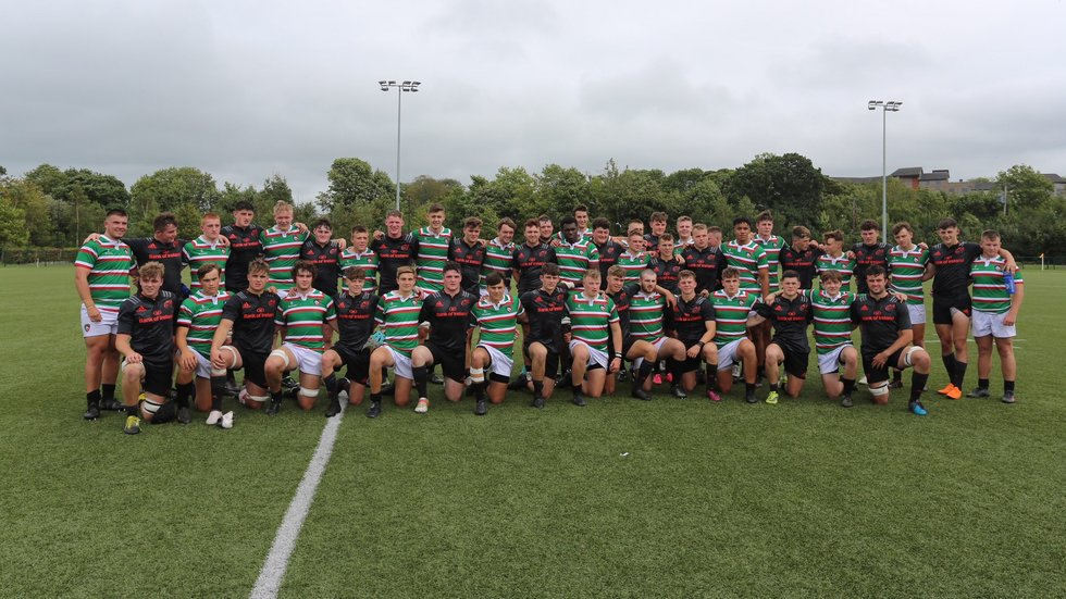 Tigers and Munster Academy players pose for a photograph following their pre-season fixture in Limerick on August 19, 2018.