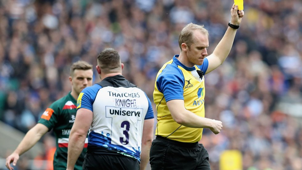 The referee shows the yellow card toBath prop Shaun Knight, taking the tension up another notch at Twickenham