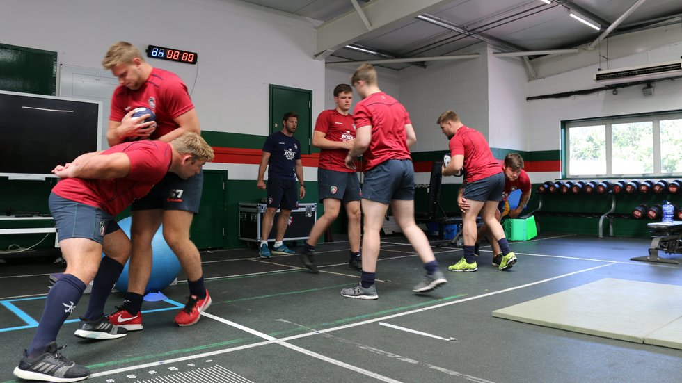 Players get involved in a defensive drill during pre-season 2018/19 under the watchful eye of assistant coach Brett Deacon.