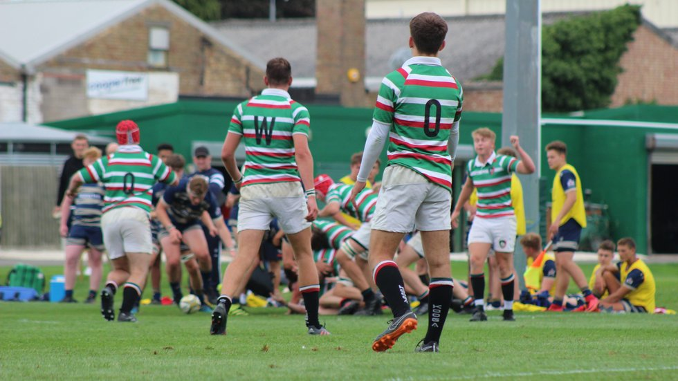 The Tigers Academy backs await the ball in attack against Bristol at Oval Park