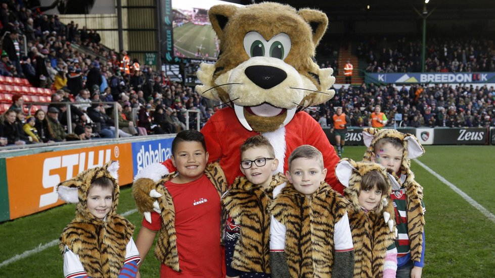 Welford wore a festive suit to meet the Tiger cubs on the pitch before kick-off