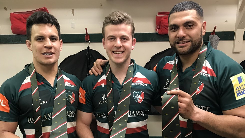 Nick Malouf receives his 20-game club tie alongside Matt Toomua (left) and Sione Kalamafoni (right)