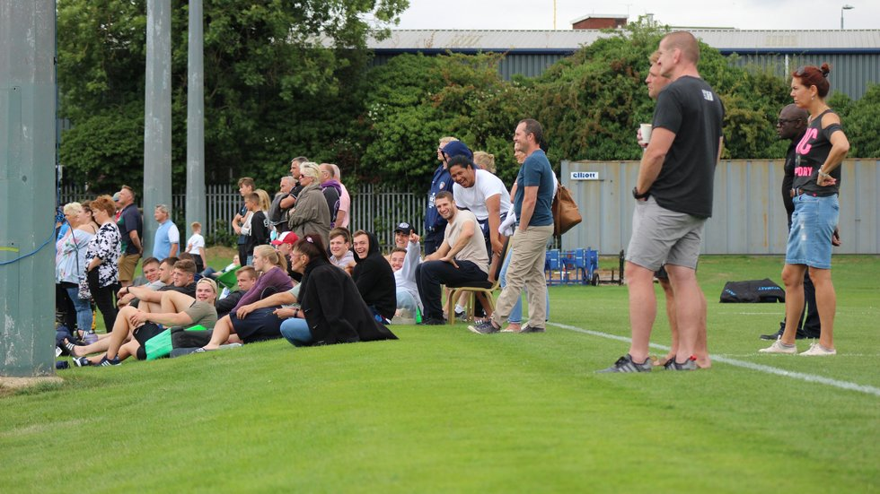 Members of the Tigers senior squad watch on in support of the Academy squad at Oval Park