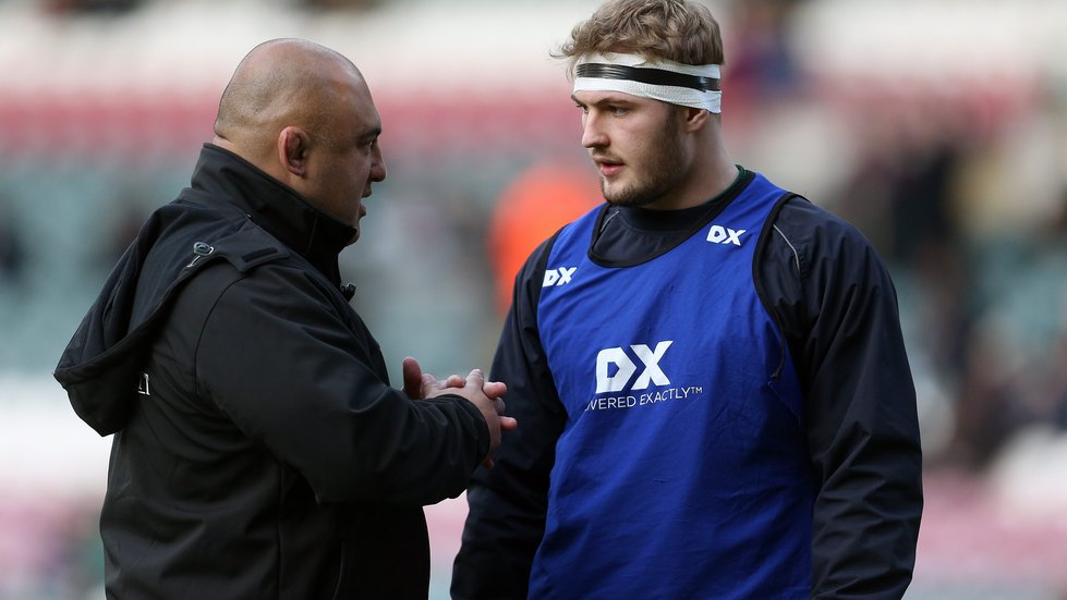 Tigers scrum coach Boris Stankovich passes on advice to young forward Sam Grahamslaw