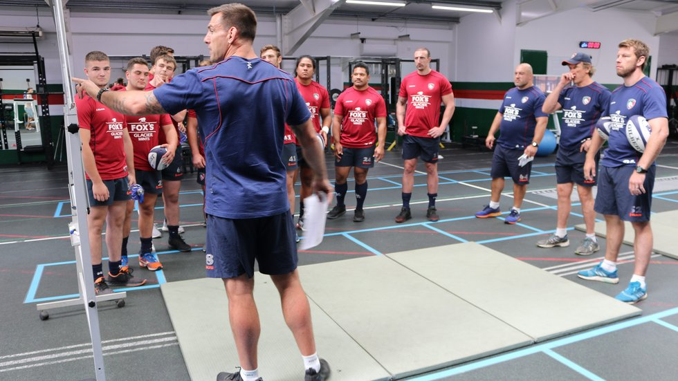 Tigers players receive their instructions from strength and conditioning coach Matt Parr in the gym during pre-season 2018/19 training.