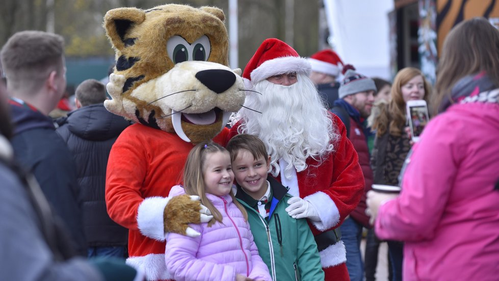 Welford and Santa meet young fans on the plaza outside the stadium