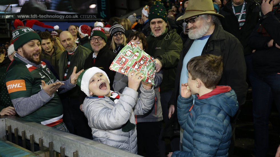 The music stops and makes one young fan very happy during the half-time Pass The Parcel