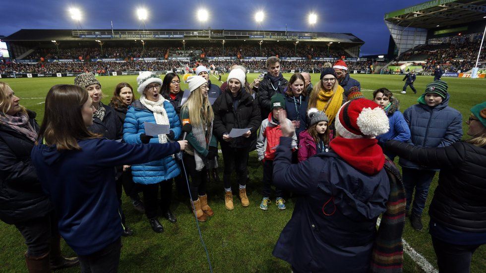 The Highs and lows Children's Choir led the singing from the pitch at half-time