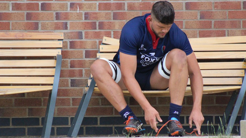 Mike Williams laces up for the pre-season session at the club's Oval Park Training Ground.