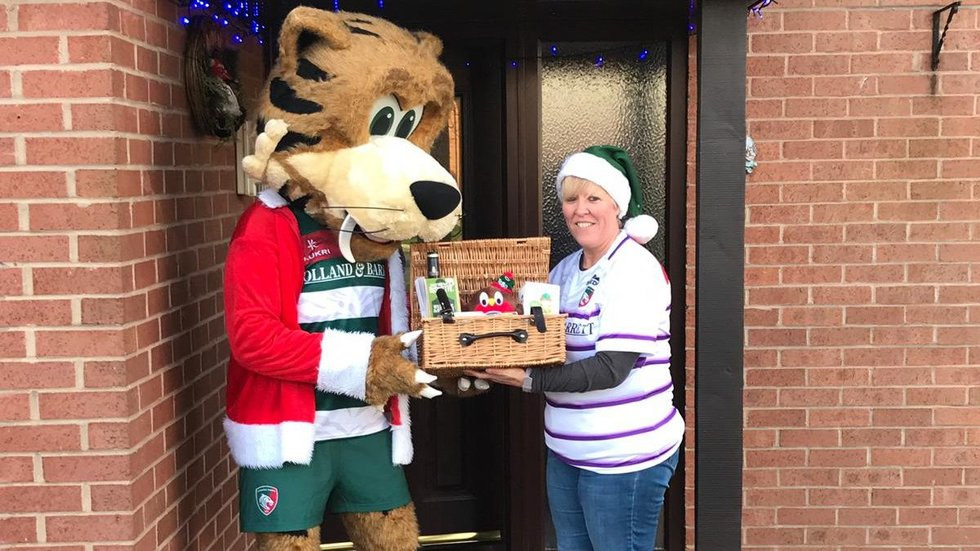 Tigers mascot Welford delivered Christmas Draw prizes personally to supporters in the TigersLotto