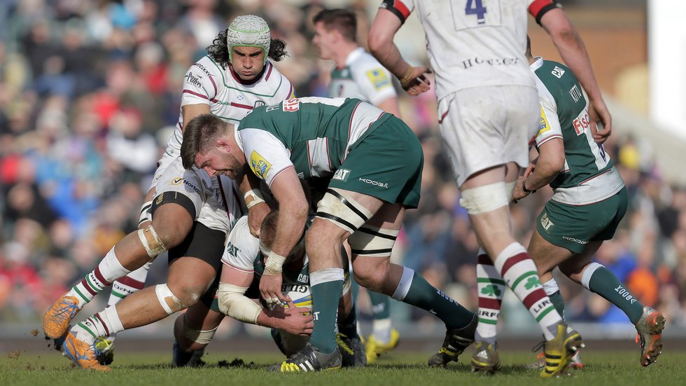 Mike Fitzgerald battles with Irish back-rower Blair Cowan during the last meeting at Welford Road