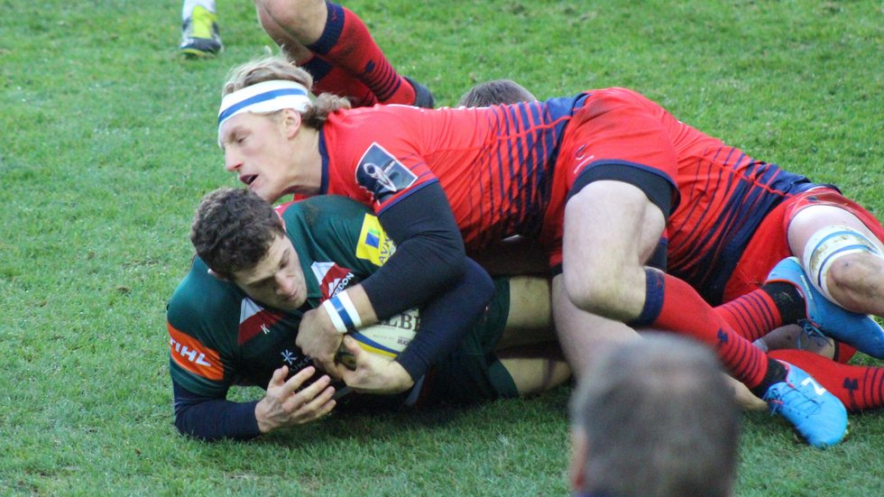 Jonah Holmes is brought down by Worcester wing Tom Howe
