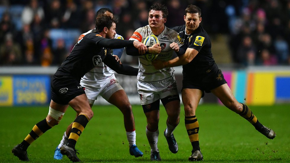 Tigers flanker Will Evans carries into the Wasps defence