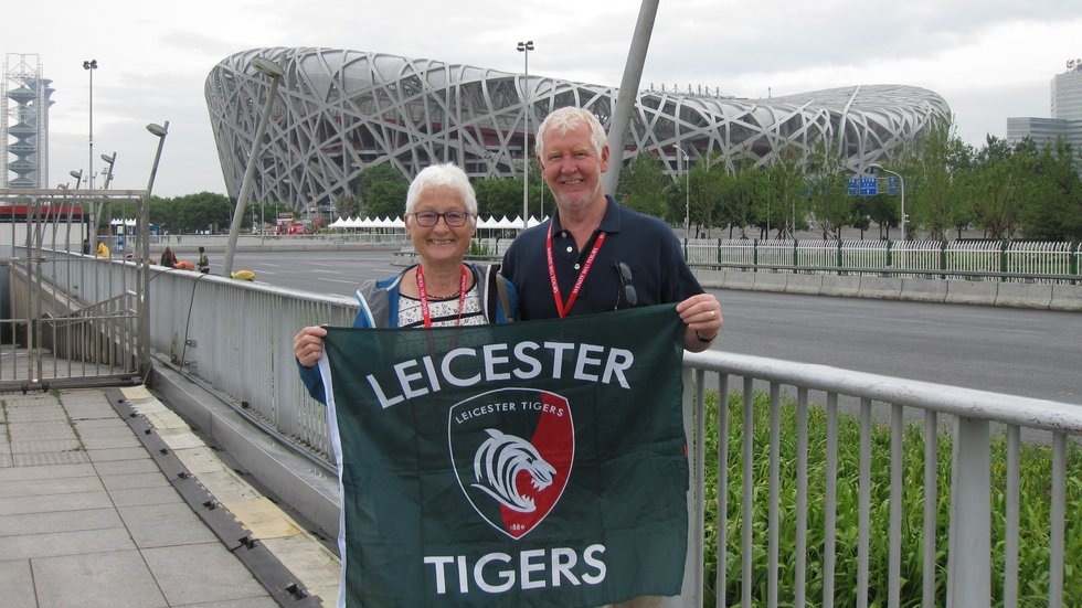 Season ticket holders Dave and Sheila Worth in front of the Olympic stadium in Beijing