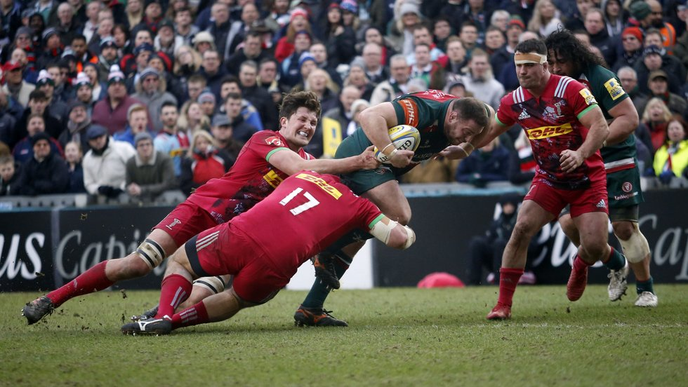 Greg Bateman ties up Quins defenders as he joins the Tigers attack