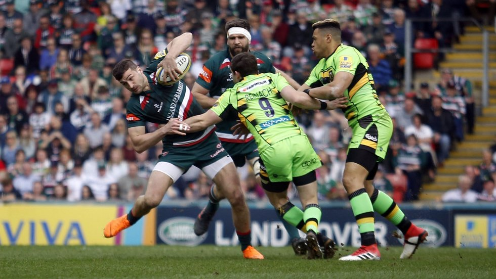 Jonny May attempts to wriggle out of the grasp of the Saints defence