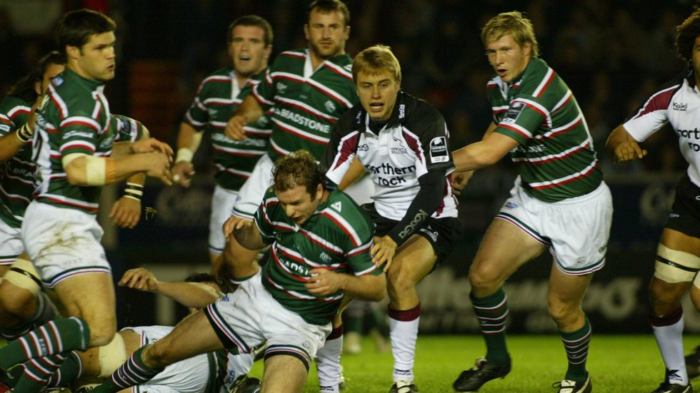 Mathew Tait caight in the crossfire at Welford Road with Falcons