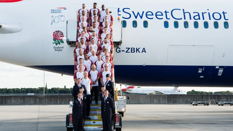 The England squad paused momentarily as they began the journey to Japan