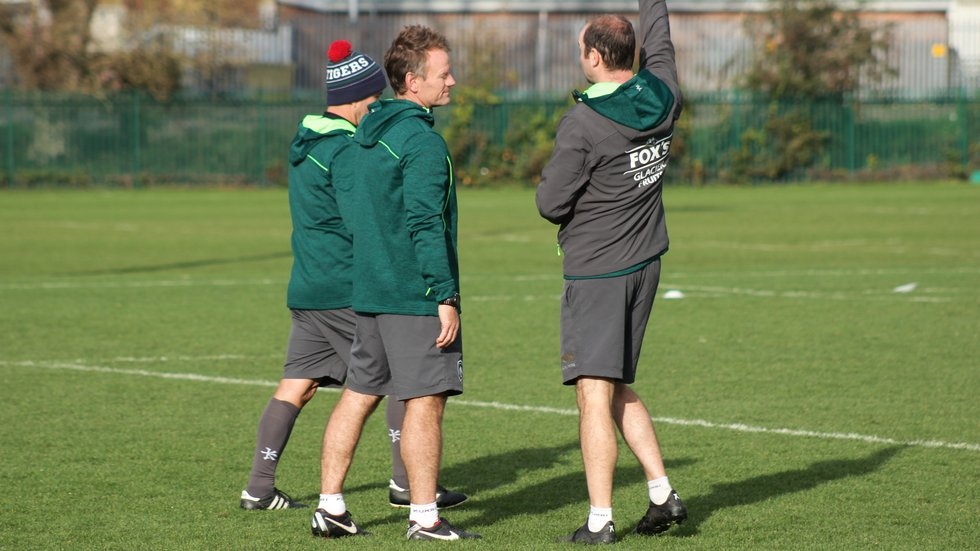 Pat Howard speaks to Tigers head coach Geordan Murphy during a training session at Oval Park