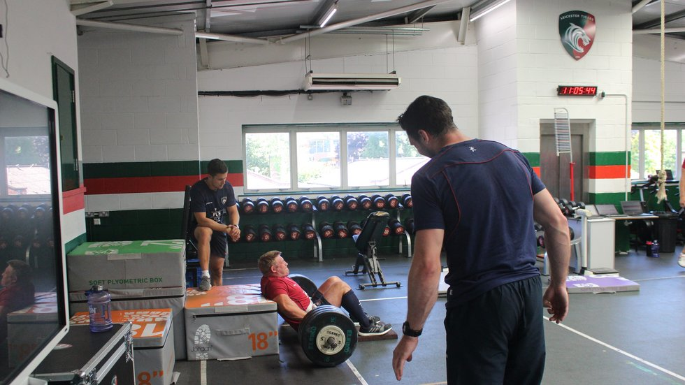 Tom Youngs in the Tigers gym as head of strength and conditioning Alex Martin watches on in pre-season 2018/19.